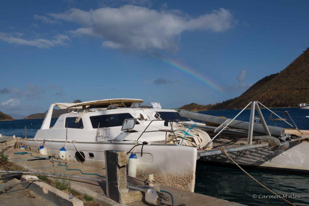 Photo of WYWH under rainbow.