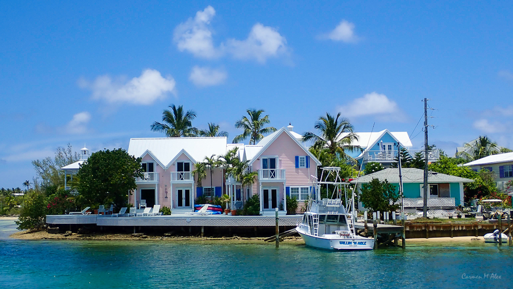 pastel colored homes along the shore