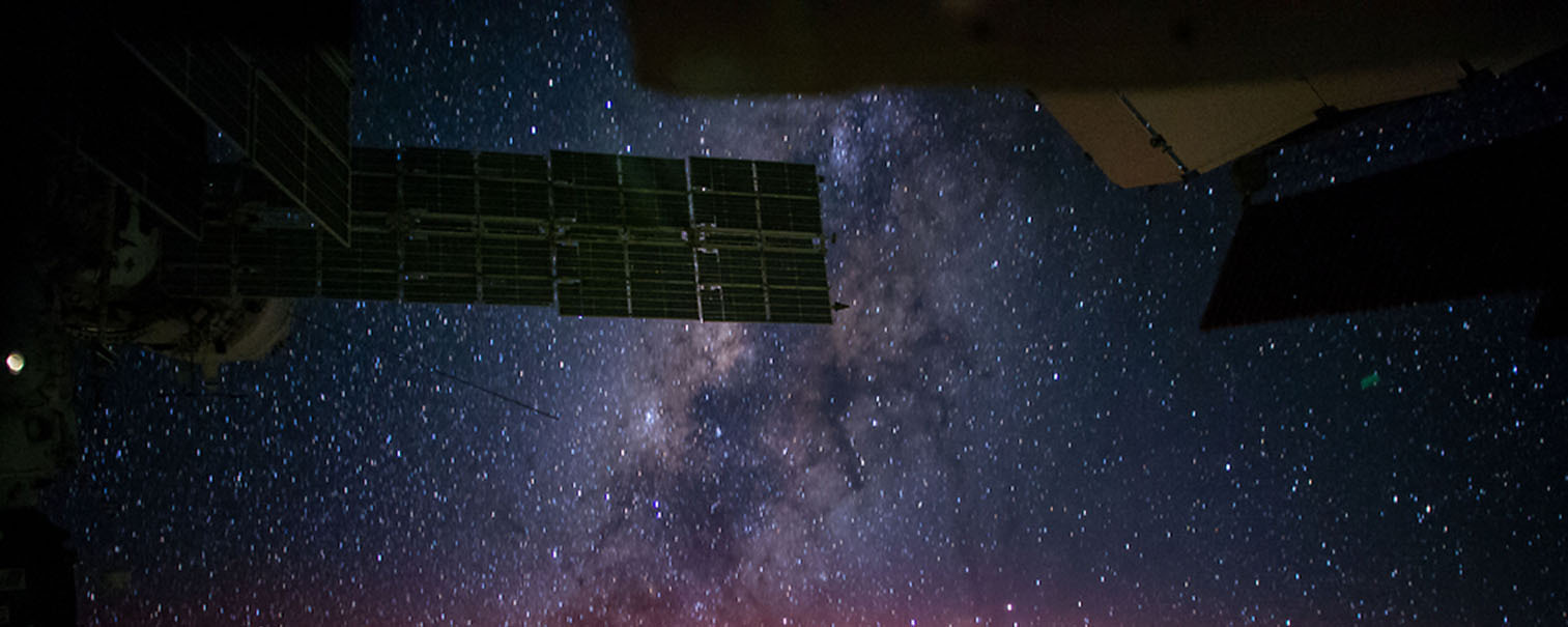 NASA astronaut image of ISS and milky way